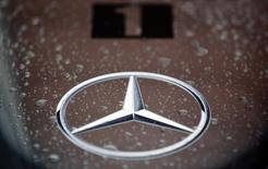Rain drops fall on a Mercedes logo on the body of a McLaren Formula One car at the pit box during the first practice session of the Turkish F1 Grand Prix at the Istanbul Park circuit in Istanbul May 6, 2011. REUTERS/Murad Sezer