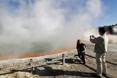 "Tourists visit mud volcanoes and geysers at Wai-O-Tapu, or ""Sacred Waters"", in the central area of New Zealand's North Island, in this file picture taken September 26, 2011.  REUTERS/Bogdan Cristel/Files"