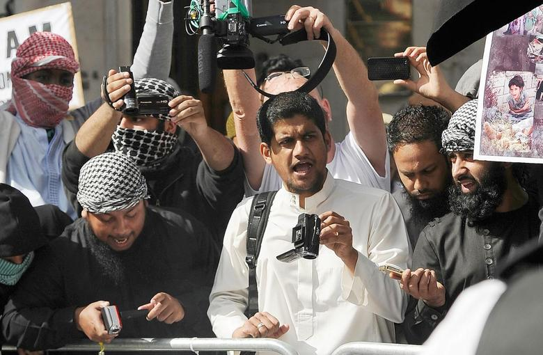 A file picture shows a man identified by local media as Siddharta Dhar (C in white) as he takes part in a demonstration outside the U.S. embassy in central London, September 11, 2011. Reuters/Paul Hackett