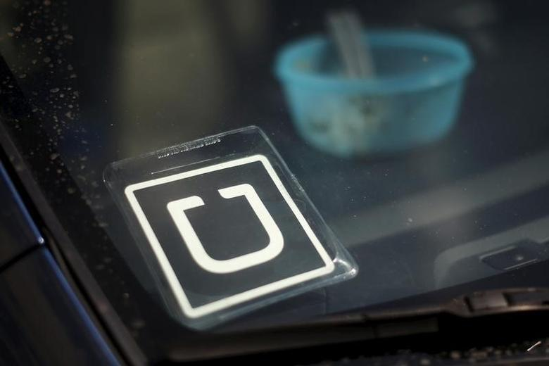 An Uber car is seen parked with the driver's lunch left on the dashboard in Venice, Los Angeles, California, United States July 15, 2015. REUTERS/Lucy Nicholson
