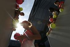 Madison Keys of the U.S. signs autographs after winning her second round match against Kazakhstan's Yaroslava Shvedova at the Australian Open tennis tournament at Melbourne Park, Australia, January 21, 2016. REUTERS/Jason Reed
