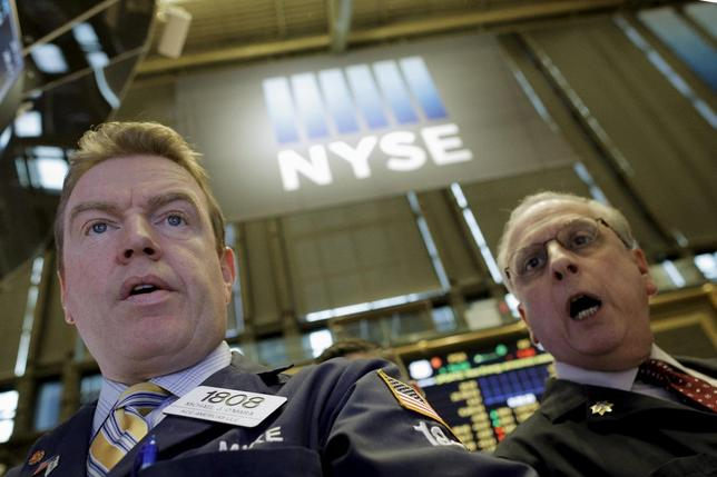 Specialist trader Michael O'Mara (L) works at his post on the floor of the New York Stock Exchange January 21, 2016. REUTERS/Brendan McDermid