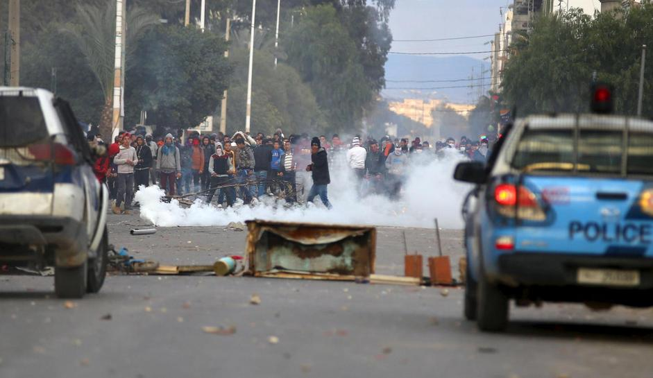 Five years on, unrest tests 'Arab Spring' model Tunisia