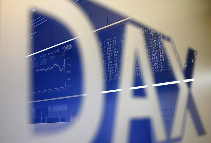 The German share price index DAX board is reflected in a DAX sign, at the stock exchange in Frankfurt September 16, 2013. REUTERS/Kai Pfaffenbach/Files