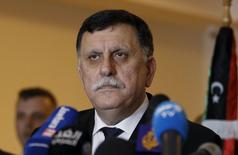Libyan prime minister-designate under a proposed National Unity government Fayez Seraj attends a joint news conference with European Union foreign policy chief Federica Mogherini in Tunis, Tunisia January 8, 2016.  REUTERS/Zoubeir Souissi