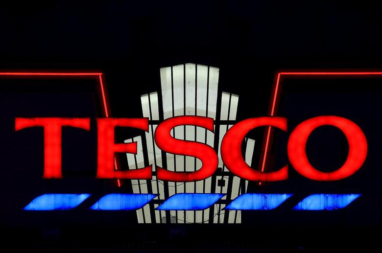 A Tesco supermarket is seen at dusk in an 'art deco' style building at Perivale in west London, Britain in this January 6, 2015 file photo. REUTERS/Toby Melville/Files