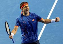 Spain's David Ferrer celebrates after winning his fourth round match against John Isner of the U.S. at the Australian Open tennis tournament at Melbourne Park, Australia, January 25, 2016. REUTERS/John French