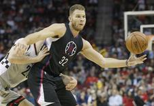 Dec 19, 2015; Houston, TX, USA; Los Angeles Clippers forward Blake Griffin (32) is defended by Houston Rockets forward Donatas Motiejunas (20) in the second half at Toyota Center. Rockets won 107 to 97.  Thomas B. Shea-USA TODAY Sports