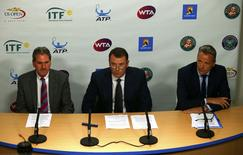 International Tennis Federation (ITF) President David Haggerty (L-R), Tennis Integrity Board Chairman Philip Brook and Association of Tennis Professionals (ATP) Chairman Chris Kermode hold a news conference at the Australian Open tennis tournament at Melbourne Park, Australia, January 27, 2016. REUTERS/Jason Reed