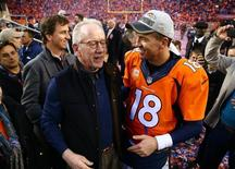 Jan 24, 2016; Denver, CO, USA; Denver Broncos quarterback Peyton Manning (18) greets father Archie Manning and brother Eli Manning after defeating the New England Patriots in the AFC Championship football game at Sports Authority Field at Mile High. Mandatory Credit: Mark J. Rebilas-USA TODAY Sports
