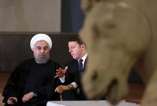 Iran President Hassan Rouhani (L) talks with Italian Prime Minister Matteo Renzi at the Campidoglio palace in Rome, Italy, January 25, 2016.  REUTERS/Alessandro Bianchi