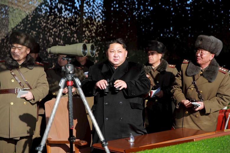 North Korean leader Kim Jong Un (C) watches a firing contest of the KPA artillery units at undisclosed location in this photo released by North Korea's Korean Central News Agency (KCNA) in Pyongyang on January 5, 2016. REUTERS/KCNA