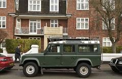 A man walks past a Land Rover Defender parked on a street in London, Britain, January 29, 2016. Production of the iconic British off road vehicle will cease today in central England, nearly seventy years since the first Defender was built. REUTERS/Toby Melville