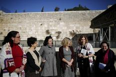 """Members of activist group """"Women of the Wall"""" speak to the media following the Israeli government's approval to create a mixed-sex prayer plaza near Jerusalem's Western Wall to accommodate Jews who contest Orthodox curbs on worship by women at the site, in Jerusalem's Old City January 31, 2016. REUTERS/Amir Cohen"""