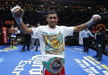 Boxing - Amir Khan v Chris Algieri - Barclays Center, Brooklyn, New York City, United States of America - 29/5/15 Amir Khan celebrates winning the fight Action Images via Reuters / Andrew Couldridge Livepic