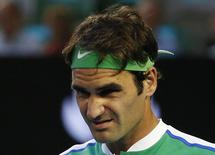 Switzerland's Roger Federer reacts during his semi-final match against Serbia's Novak Djokovic at the Australian Open tennis tournament at Melbourne Park, Australia, in this January 28, 2016 file photo. REUTERS/Tyrone Siu/Files