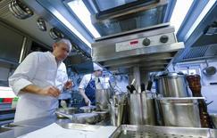 "Belgian chef Peter Goossens (L) cooks in his three Michelin stars restaurant ""Hof van Cleve"" in Kruishoutem, south of the city of Ghent, Belgium February 3, 2016. REUTERS/Yves Herman"