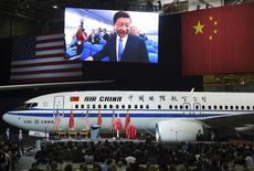 Chinese President Xi Jinping is pictured on a giant screen as he tours a 737-800 jet at the Boeing assembly line in Everett, Washington September 23, 2015. REUTERS/Mark Ralston/Pool  - RTX1S5WC