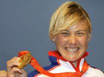 Sarah Ayton of Britain, competing in Yngling class, holds her gold medal following the medal presentation at the Beijing 2008 Olympic Games in Qingdao, Shandong province in this August 17, 2008 file photo. REUTERS/Peter Andrews/Files