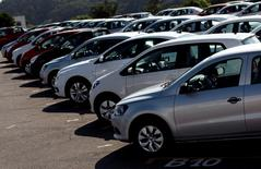 Vehicles sit parked in a lot at a General Motors vehicle factory in Sao Jose dos Campos near Sao Paulo, February 23, 2015. REUTERS/Roosevelt Cassio