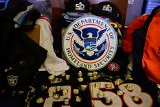 Feb 4, 2016; San Francisco, CA, USA; A general view of counterfeit merchandise on display at the counterfeit merchandise press conference prior to Super Bowl 50 between the Carolina Panthers and the Denver Broncos. Mandatory Credit: Kirby Lee-USA TODAY Sports