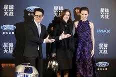 """Director JJ Abrams (L) and producer Kathleen Kennedy (C) and cast member Daisy Ridley arrive at the China premiere of the film """"Star Wars: The Force Awakens"""" in Shanghai, China, December 27, 2015. REUTERS/Aly Song"""