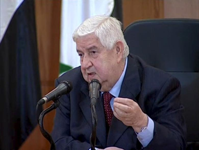 Syrian Foreign Minister Walid al-Moualem speaks during a news conference at the Syrian Foreign Ministry in Damascus, in this still image taken from video shot on February 6, 2016. REUTERS/SYRIAN TV via Reuters TV