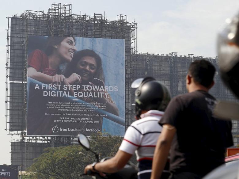 Motorists ride past a billboard displaying Facebook's Free Basics initiative in Mumbai, India, December 30, 2015. REUTERS/Danish Siddiqui