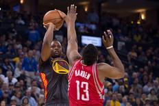 February 9, 2016; Oakland, CA, USA; Golden State Warriors forward Harrison Barnes (40) shoots the basketball against Houston Rockets guard James Harden (13) during the fourth quarter at Oracle Arena. The Warriors defeated the Rockets 123-110. Mandatory Credit: Kyle Terada-USA TODAY Sports