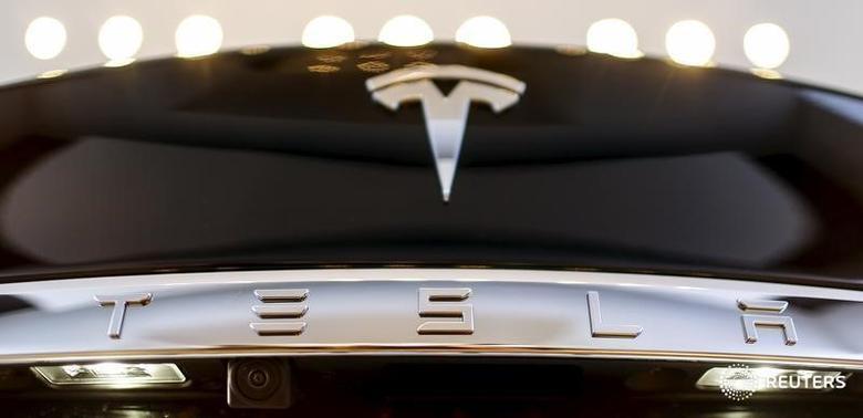 A Tesla logo adorns a 'Model S' car in the dealership in Berlin, Germany, November 18, 2015. REUTERS/Hannibal Hanschke