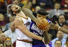 Feb 8, 2016; Cleveland, OH, USA; Cleveland Cavaliers forward Kevin Love (0) defends Sacramento Kings center DeMarcus Cousins (15) in the third quarter at Quicken Loans Arena. Mandatory Credit: David Richard-USA TODAY Sports