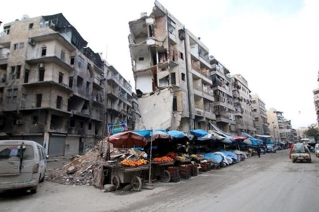 Stalls are seen on a street beside damaged buildings in the rebel held al-Shaar neighborhood of Aleppo, Syria, February 10, 2016. REUTERS/Abdalrhman Ismail