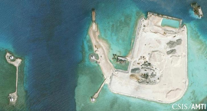 The artificial island at the southern end of Mischief Reef showing a newly-built seawall on its north side and a completed dock are shown in this Center for Strategic and International Studies (CSIS) Asia Maritime Transparency Initiative January 8, 2016 satellite image released to Reuters on January 15, 2016. REUTERS/CSIS Asia Maritime Transparency Initiative/Digital Globe/Handout via Reuters/Files
