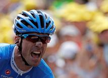 Garmin-Sharp rider David Millar of Britain reacts on the finish line as he wins the 12th stage of the 99th Tour de France cycling race between Saint-Jean-de-Maurienne and Annonay-Davezieux, July 13, 2012.  REUTERS/Jean-Paul Pelissier