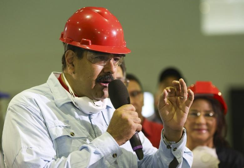 Venezuela's President Nicolas Maduro (L) talks during the opening ceremony of a plant of PVC tubes in the state of Carabobo, in this handout picture provided by Miraflores Palace on February 11, 2016. REUTERS/Miraflores Palace/Handout via Reuters