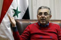 Министр по делам национального примирения Сирии Али Хайдар дает интервью Рейтер в своем офисе в Дамаске. Российские посредники помогают сирийскому правительству достигать договоренностей с повстанцами, желающими сложить оружие или переместиться в свои опорные пункты, поскольку Москва добивается локального перемирия с осажденными бойцами оппозиции. REUTERS/Omar Sanadiki