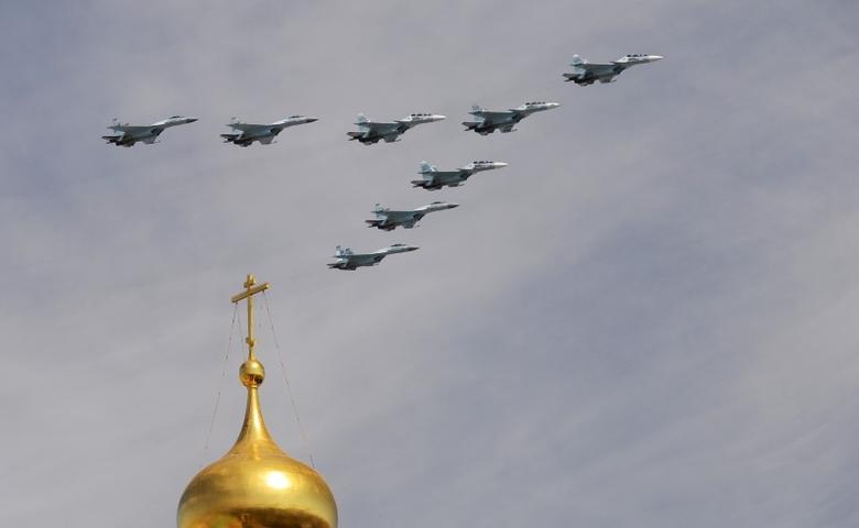 Russian Sukhoi Su-30SM Flanker-C fighters and Su-35S Super-Flanker fighters fly in formation over the Red Square during the Victory Day parade in Moscow, Russia, May 9, 2015.  REUTERS/Host Photo Agency/RIA Novosti