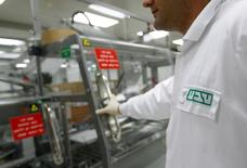 An employee of Teva Pharmaceutical Industries wears a shirt bearing the company's logo at its Jerusalem oral solid dosage plant (OSD) December 21, 2011. REUTERS/Ronen Zvulun