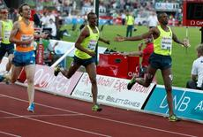 (L-R) Nick Willis of New Zealand, Homiyu Tesfaye of Germany and Ayanleh Souleiman of Djibouti cross the finish line during the ExxonMobil Dream Mile at the IAAF Diamond League at the Bislett Stadium in Oslo June 11, 2014. REUTERS/Jon Eeg/NTB Scanpix