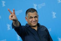 Director Mani Haghighi poses during a photocall to promote the movie 'Ejhdeha Vared Mishavad!' ('A Dragon Arrives!') at the 66th Berlinale International Film Festival in Berlin, Germany February 19, 2016. REUTERS/Stefanie Loos