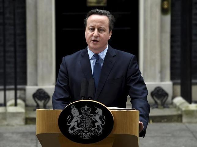2月20日、キャメロン英首相は欧州連合(EU)首脳会議が英国のEU残留に向けた改革案で合意したことを受け、残留の是非を問う国民投票を6月23日に行うと表明した(2016年 ロイター/Toby Melville)