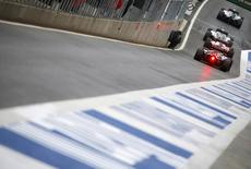 Formula one cars wait in the pitlane during the third practice session of the Austrian F1 Grand Prix at the Red Bull Ring circuit in Spielberg, Austria, June 20, 2015. REUTERS/Laszlo Balogh