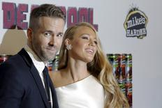 """Actor Ryan Reynolds poses with his wife actress Blake Lively at the premiere of """"Deadpool"""" in New York, February 8, 2016. REUTERS/Brendan McDermid"""