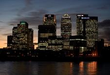 The Canary Wharf financial district is seen at dusk in east London November 7, 2014.  REUTERS/Toby Melville