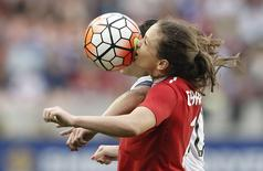 Feb 21, 2016; Houston, TX, USA; Canada forward Christine Sinclair (12) and USA midfielder Carli Lloyd (10) head the ball in the second half during the 2016 CONCACAF women's Olympic soccer tournament at BBVA Compass Stadium. Mandatory Credit: Thomas B. Shea-USA TODAY Sports