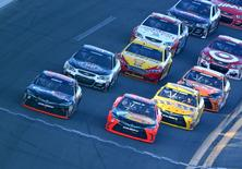 NASCAR Sprint Cup Series driver Denny Hamlin (left) beats Martin Truex Jr. (78) to the finish line to win.  Mark J. Rebilas-USA TODAY Sports