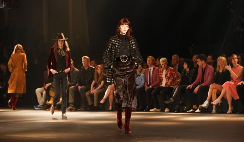 a821f807 A model presents a creation from the Saint Laurent fall collection during a fashion  show at