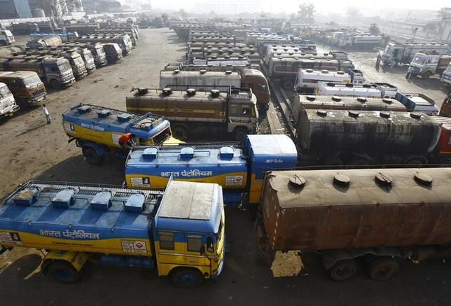 Oil tankers are seen parked at a yard outside a fuel depot on the outskirts of Kolkata February 3, 2015. REUTERS/Rupak De Chowdhuri