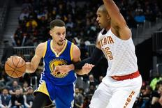 Feb 22, 2016; Atlanta, GA, USA; Golden State Warriors guard Stephen Curry (30) is defended by Atlanta Hawks center Al Horford (15) during the first half at Philips Arena. Mandatory Credit: Dale Zanine-USA TODAY Sports