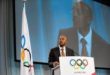 International Olympic Committee (IOC) member Namibian former sprinter Frankie Fredericks speaks at the second part of the 121st International Olympic Committee session in the Bella Center in Copenhagen, October 8, 2009.   REUTERS/Scanpix/Keld Navntoft